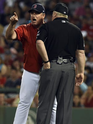 Red Sox manager John Farrell  argues with umpire Bill Miller over a balk call.
