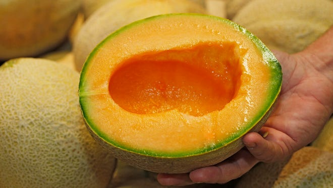 A cut-open cantaloupe is shown at a Colorado grocery store in 2012.