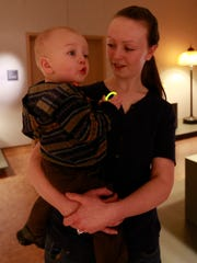 Kim Gilray interacts with her 17-month-old son Joel Friday in an exhibit of Tiffany Glass at Leigh Yawkey Woodson Art Museum in Wausau.