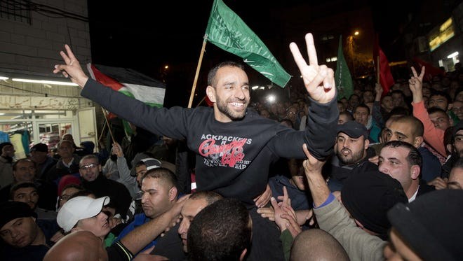 Palestinian prisoner Samer Issawi celebrates his release from an Israeli jail on Dec. 23.