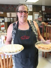 Cheryl Marchi of Crazy Mountain Inn in Martinsdale shows off the diner's pies.