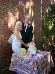 Tina Brigham and Steve Carlsen cut the wedding cake, which was created by Pam Simays.