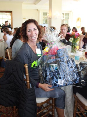 Janine Chilson after she won a basket at Homeless Solutions Women's Day of Adventure ticket auction.