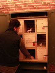 Lee Wilson, owner of the Jackson Escape Rooms, resets clues in one of the puzzle-filled rooms in this January file photo.