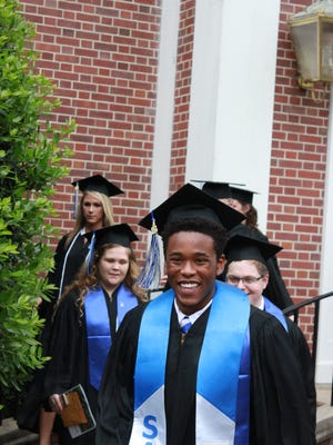 University of Memphis Lambuth graduates exit the R.E. Womack Chapel after a baccalaureate ceremony Sunday.