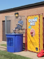 Jeff Sisk, director of the Tennessee College of Applied Technology Jackson, prepares to go into the dunking booth at a welcoming event for students on Thursday.