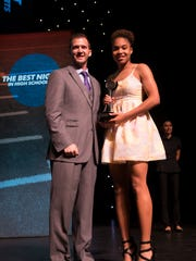 Yasmeen Chang, a sophomore at Gulf Coast High School, accepts the award for the Naples Daily News girls basketball award during the Southwest Florida Sports Awards at the Barbara B. Mann Performing Arts Center Wednesday, May 24, 2017 in Fort Myers, Fla. Chang would also win the Naples Daily News girls athlete of the year award.