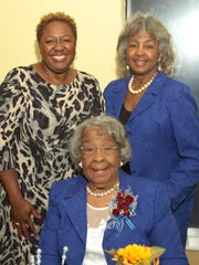90th Birthday Honoree Melanie Jones Thibodeaux (clockwise, from seated), Paul Quinn College Dean Kelsel Thompson and Thibodeaux's daughter/party host Roslyn Thibodeaux Goodal, of Dallas, l at the party at Wyndham Garden Inn.