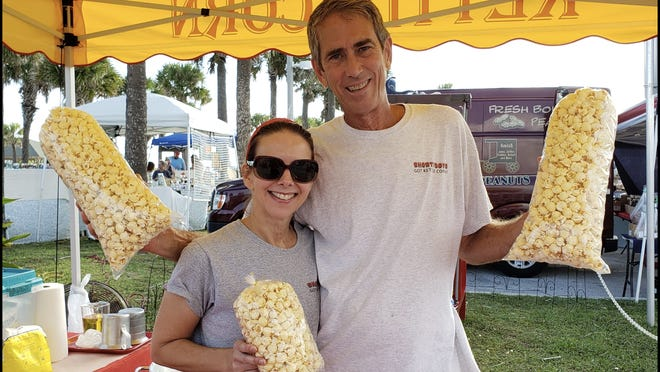 Mark and Kirstin Holdren of Shortyboys kettle corn at the farmers market.