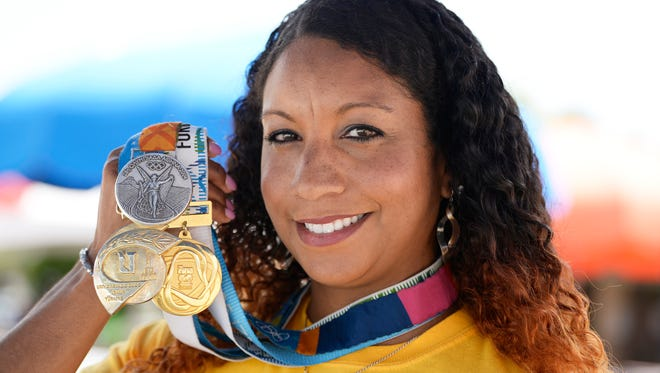 Maritza McClendo,n 2004 Olympic Silver Medalist and the first female African American to make the U.S. Olympic Swim Team, displays her medals.