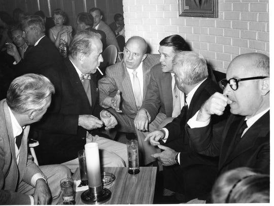 Humphrey Bogart, smoking, with Jimmy Van Heusen, Earl