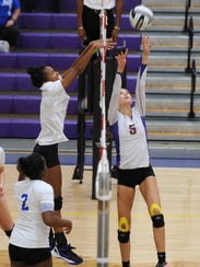 Unioto's Madi Eberst sets a ball against Chillicothe