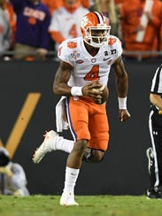 Clemson quarterback Deshaun Watson runs for a big gain