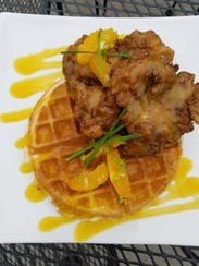 Crispy chicken and champagne waffles with a mimosa