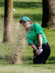 Cassidy Kramp of Greendale hits out of the sand at