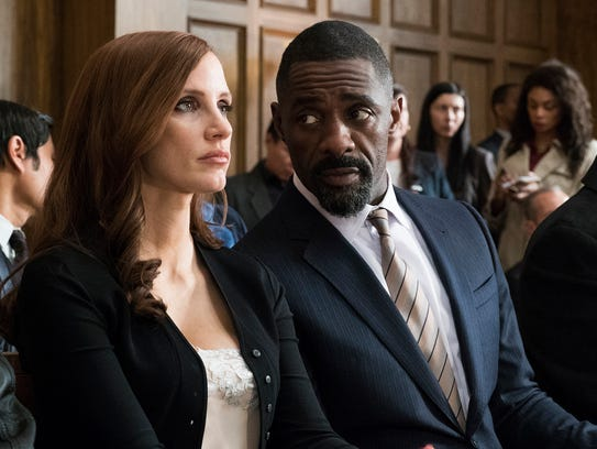 "Jessica Chastain and Idris Elba in ""Molly's Game."""
