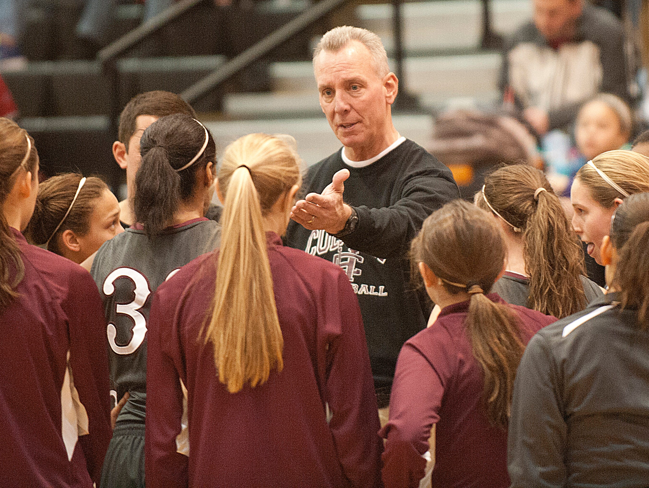 Henderson County Lady Colonels head basketball coach Jeff Haile talks to his players during a time-out. 24 January 2015