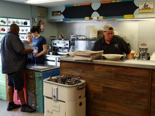 Jason Roy prepares food at the S. Asheville Biscuit Head location.