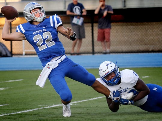 Whitefish Bay's Cade Garcia completes a pass while