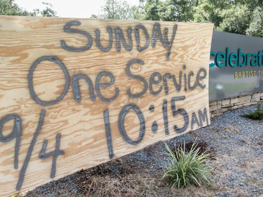 Hundreds of worshipers participate during a makeshift outdoor service at Celebration Baptist Church after Hurricane Hermine left them without electricity.