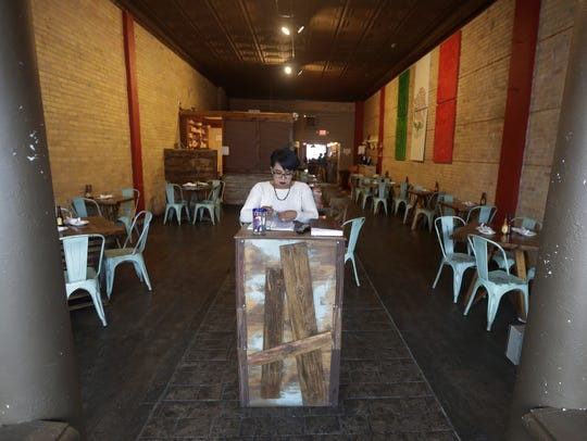 Manager Ana Reyes works Wednesday at Antojitos Mexicanos