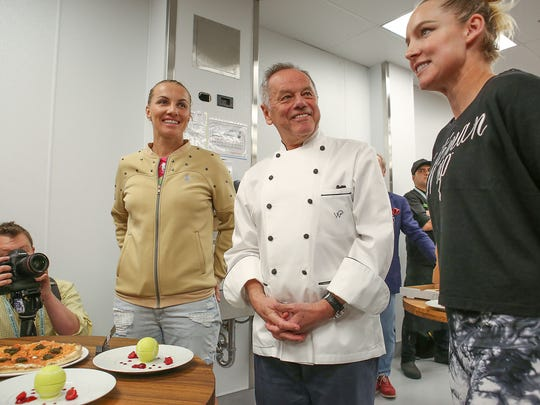 Wolfgang Puck, center, talks with WTA tennis players Bethanie Mattek, right, and Svetlana Kutzetsova during a debut of the new foods at the BNP Paribas Open in Indian Wells, Tuesday, March 7, 2017.