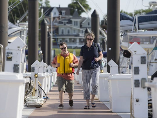 J.C Maimone and his mother Maureen walk along a dock