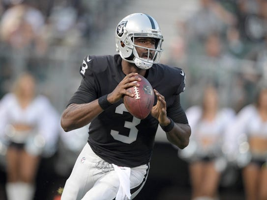 Oakland Raiders quarterback E.J. Manuel (3) throws