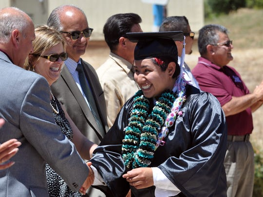 Carolina Martinez is congratulated at the graduation on Thursday, June 16th of the Rancho Cielo Construction Academy in Salinas.