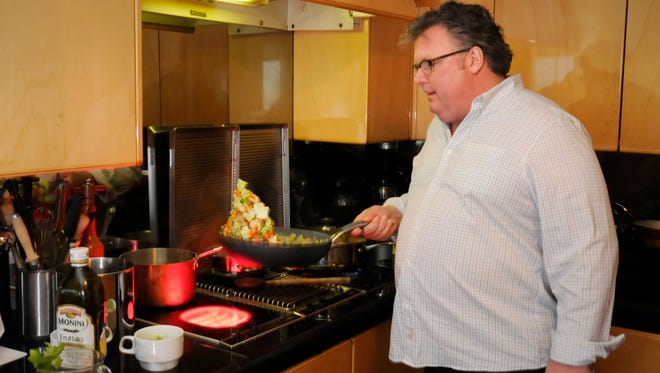 Celebrity chef David Burke cooking at his home