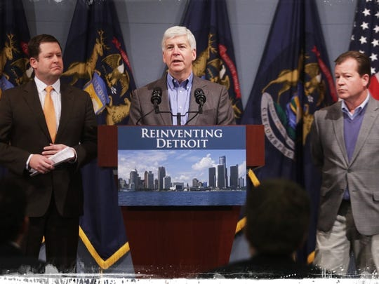 Gov. Rick Snyder, accompanied by Speaker of the House Jase Bolger, left, and Senate Majority Randy Richardville, announces a state funding commitment to the grand bargain on Jan. 22.