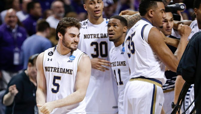 Notre Dame's Matt Farrell (5), Zach Auguste (30) and Demetrius Jackson (11) celebrate with teammates after a second-round men's college basketball game against Stephen F. Austin in the NCAA Tournament, Sunday, March 20, 2016, in New York.  (AP Photo/Frank Franklin II)