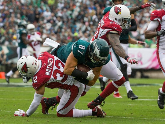 Eagles' Brent Celek collides with Arizona's Tyrann Mathieu and Deone Bucannon during their game Sunday at Lincoln Financial Field.
