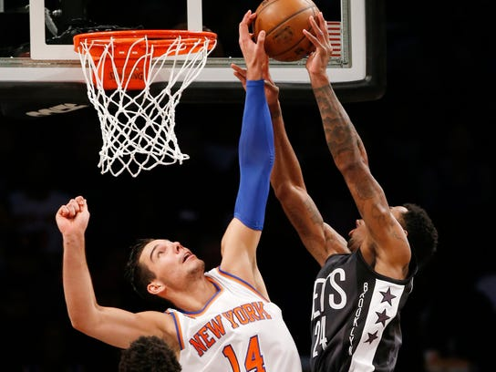 New York Knicks center Willy Hernangomez (14) blocks a shot by Brooklyn Nets forward Rondae Hollis-Jefferson (24) in the first half of an NBA basketball game, Sunday, March 12, 2017, in New York. (AP Photo/Kathy Willens)