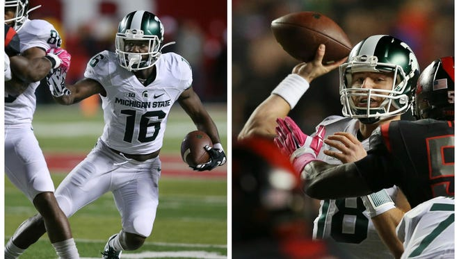 Never more has Michigan State needed quarterback Connor Cook, right, and Aaron Burbridge, left, to be special than this weekend at Michigan.