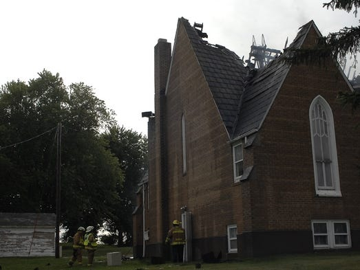 Rudolph and Grand Rapids fire departments battled a fire Tuesday at the Rudolph Moravian Church, 1490 Main St.