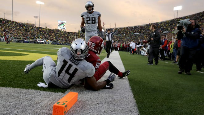 Washington State wide receiver Dom Williams (80) hangs onto the football after a touchdown catch Saturday at Autzen Stadium, an all-too-familiar scene for Oregon fans.