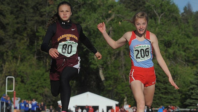 Harrisburg's Erin Kinney (left) competes against Lincoln's Mollie Kersten at the state meet last meet.