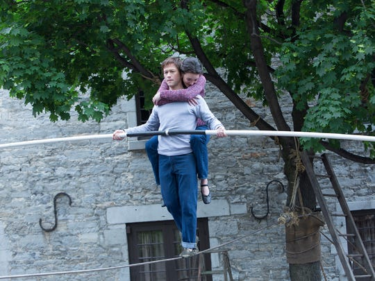 "This photo provided by Sony shows, Joseph Gordon-Levitt as Philippe Petit and Charolette Le Bon as Annie, in TriStar Pictures' ""The Walk."" (Takashi Seida/Sony via AP)"