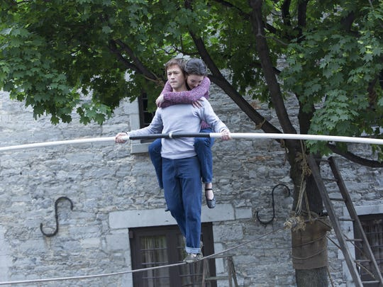 """This photo provided by Sony shows Joseph Gordon-Levitt as Philippe Petit and Charolette Le Bon as Annie in TriStar Pictures' """"The Walk."""" This photo provided by Sony shows, Joseph Gordon-Levitt as Philippe Petit and Charolette Le Bon as Annie, in TriStar Pictures' """"The Walk."""""""