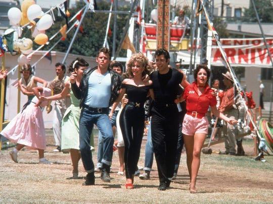 """Jeff Conaway (as Kenickie), Olivia Newton-John (as Sandy Olsson), John Travolta (as Danny Zuko) and Stockard Channing (as Betty Rizzo) appear in the ending of """"Grease."""""""
