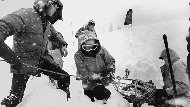 Rescuers pull a victim from an avalanche March 31, 1982, at Alpine Meadows.