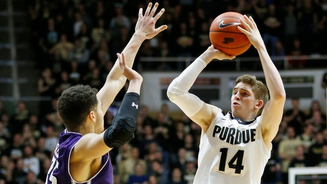 Ryan Cline with a three-point shot over Aaron Falzon of Northwestern Tuesday, February 16, 2016, at Mackey Arena. Purdue defeated Northwestern 71-61.