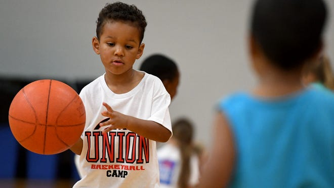 Aaron Haliburton makes a bounce-pass to his fellow camper Solomon Hammond during the Union University pee wee summer basketball camp, Monday, June 5.