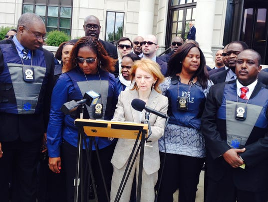 Parole officers charge racial profiling