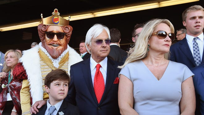 The Burger King joins trainer Bob Baffert, center, and his family as they watch American Pharoah win the Triple Crown on June 6, 2015, at Belmont Park in Elmont, New York. The Burger King was on hand again Saturday when Baffert watched Justify become the 13th horse to win a Triple Crown championship.