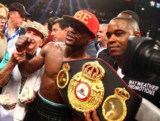 Floyd Mayweather celebrates his victory against Marcos Maidana following their fight at MGM Grand.