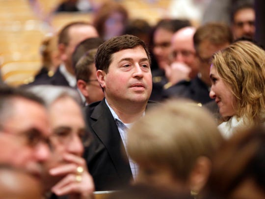 """Milwaukee Bucks President Peter Feigin is seen in the crowd at Milwaukee Mayor Tom Barrett's 2016 """"state of the city"""" speech at the Hmong American Peace Academy at 4601 N. 84th St. in Milwaukee Feb. 8, 2016."""