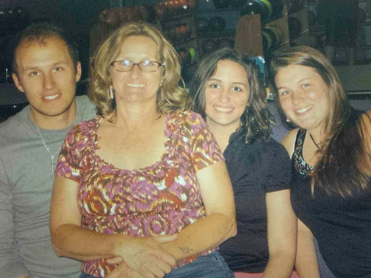 Barbara Schrum, second from the left, is pictured with her children, from the left, Matt Armold, Alecia Armold and Becky Schrum. In May 2015, Barbara Schrum was killed by Martin Kepner who also killed his estranged wife, Laurie Kuykendall Kepner, and then himself.