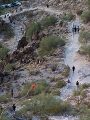 Hikers make their way up Piestewa Peak as some try and complete the Seven Summit Challenge in Phoenix on Nov. 15, 2014. The challenge has the hikers climb seven peaks in 11 hours.
